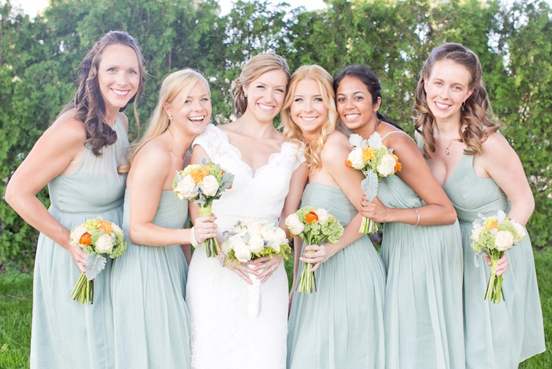 e4609c03684 Bride in a lace Watters dress and bridesmaids in different seafoam J.Crew  dresses