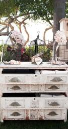 Floral birdcages on top of vintage dresser