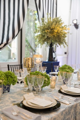 blue and white table setting, green flower arrangement, southern-inspired wedding low centerpieces