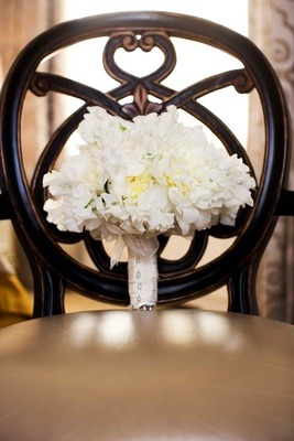 White peony and garden rose bouquet on chair