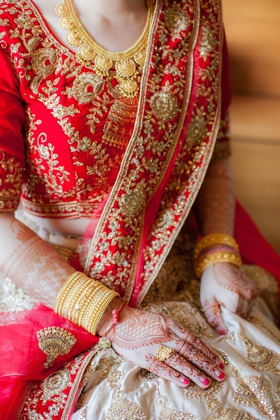 japanese bride in indian wedding attire henna lehenga red gold embroidery jewels