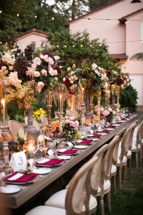wedding reception outdoor long table wood cane chair tall centerpiece fall wedding ideas greenery