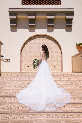 bride in backless berta wedding dress with sparkling a-line tulle skirt