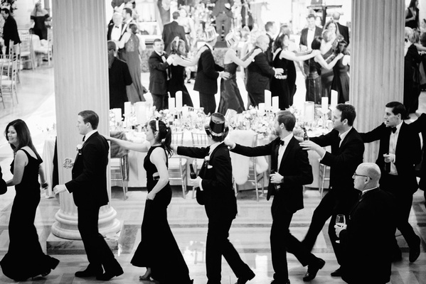 black and white photo of guests at new year's eve wedding reception new year's hats and tiaras