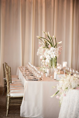 long tablescape classic motif glass elements roses orchids calla lilies hydrangea bel-air bay club