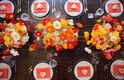 Head table wood with poppy centerpiece pink napkin heart shape favors white yellow orange pink red