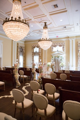 wedding ceremony seating with a mix of old-fashioned pews and cushioned chairs