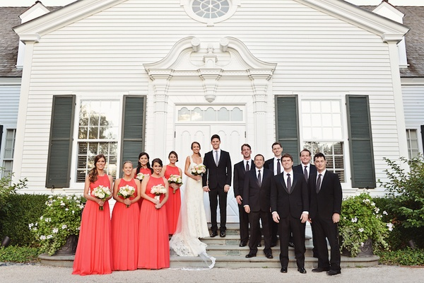 Bride in Ines Di Santo dress with coral bridesmaids and groomsmen