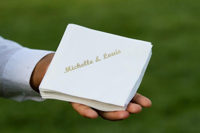 White beverage napkin with gold couple names
