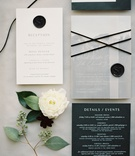 wedding invitation with black wax seal monogram reception card and detail event card for the weekend