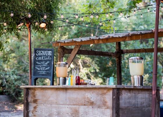 wedding at barn venue in santa barbara wood bar with chalkboard sign signature cocktails