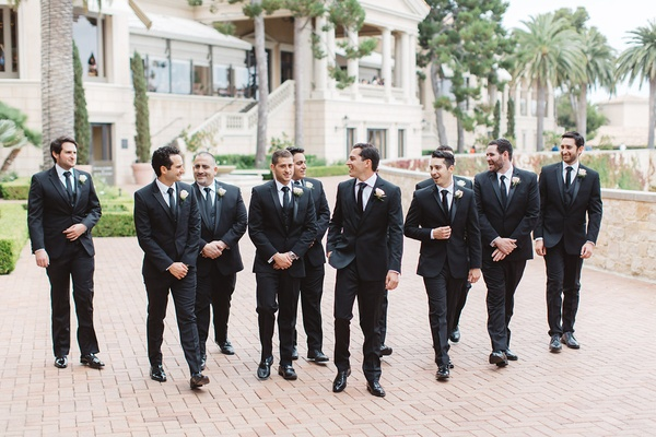 groom groomsmen walking black suits pelican hill resort wedding newport california sleek mens attire