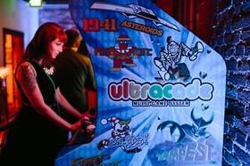 Wedding guest playing Ultracade game system at reception