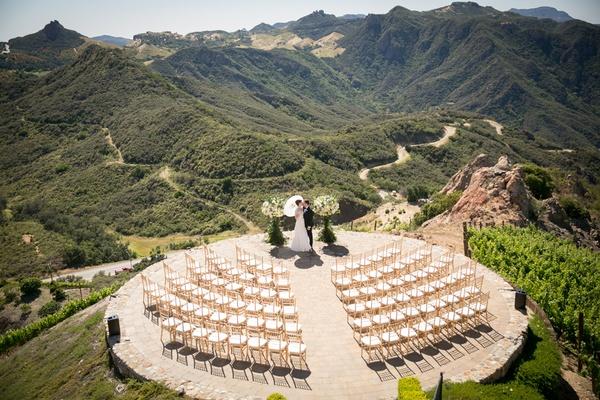 malibu rocky oaks wedding ceremony on helipad, bride with parasol