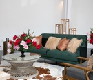kentucky derby themed bridal shower, emerald couch, leather pillow, cow skin rug, red and pink roses