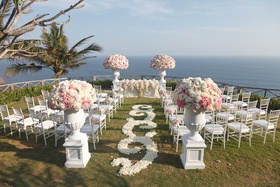 White rose petal swirl aisle at pink and white flower ceremony