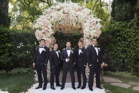 wedding ceremony decor groom and groomsmen in tuxedos bow ties beverly hills hotel