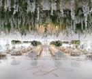 wedding reception large white dance floor gold monogram with flower chandelier ceiling installation