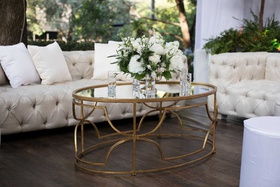 wedding cocktail table gold ivory chesterfield sofa tufted greenery white flowers pillows