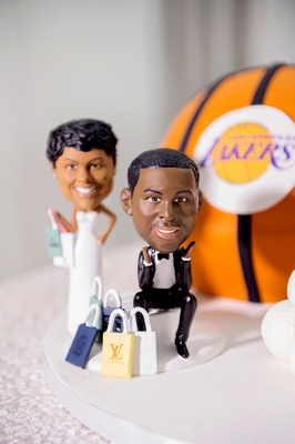 Wedding reception groom's cake bride and groom lifelike cake topper shopping and lakers basketball