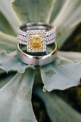 Three-row ring with yellow diamond and halo
