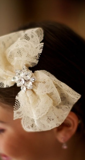 Lace bow adorned with pair-shaped crystals