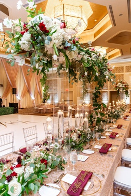 Wedding reception long head table dance floor burgundy flowers napkin greenery nuage designs linens