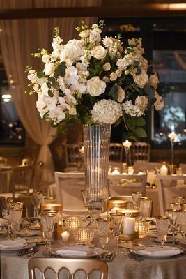 tall wedding reception centerpiece white hydrangea phalaenopsis orchid rose flower glass vase candle