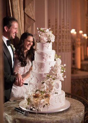 wedding reception cake ron ben israel lace design sugar flowers cascading down with topper
