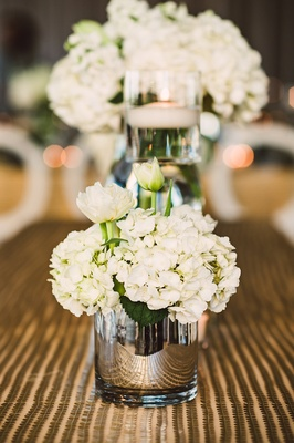 Gold sequin stripe linen reflective vase with white hydrangea and flower bouquet candle floating