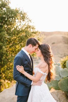 bride in off shoulder galia lahav wedding dress hair worn down prickly pear cactus mountain golden