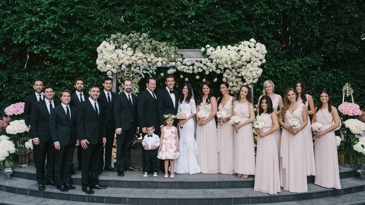 Bridesmaids in pink Joanna August bridesmaid dresses, flower girl, ring bearer, groomsmen in suits