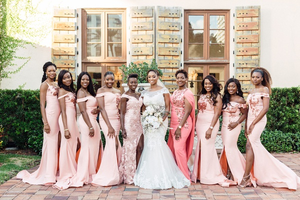 bridesmaids in off-the-shoulder blush gowns with thigh slits from nigeria
