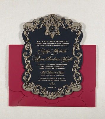 Red scallop envelope with black invitation gold crest and design around border of invitation wedding