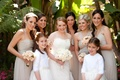Two flower girls with bridesmaids in tan dresses
