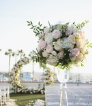 wedding ceremony pink rose white hydrangea greenery arrangement circle arch flower petal aisle
