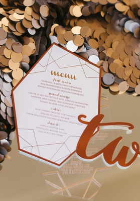 a contemporary design for a reception menu in a copper color on large sequins