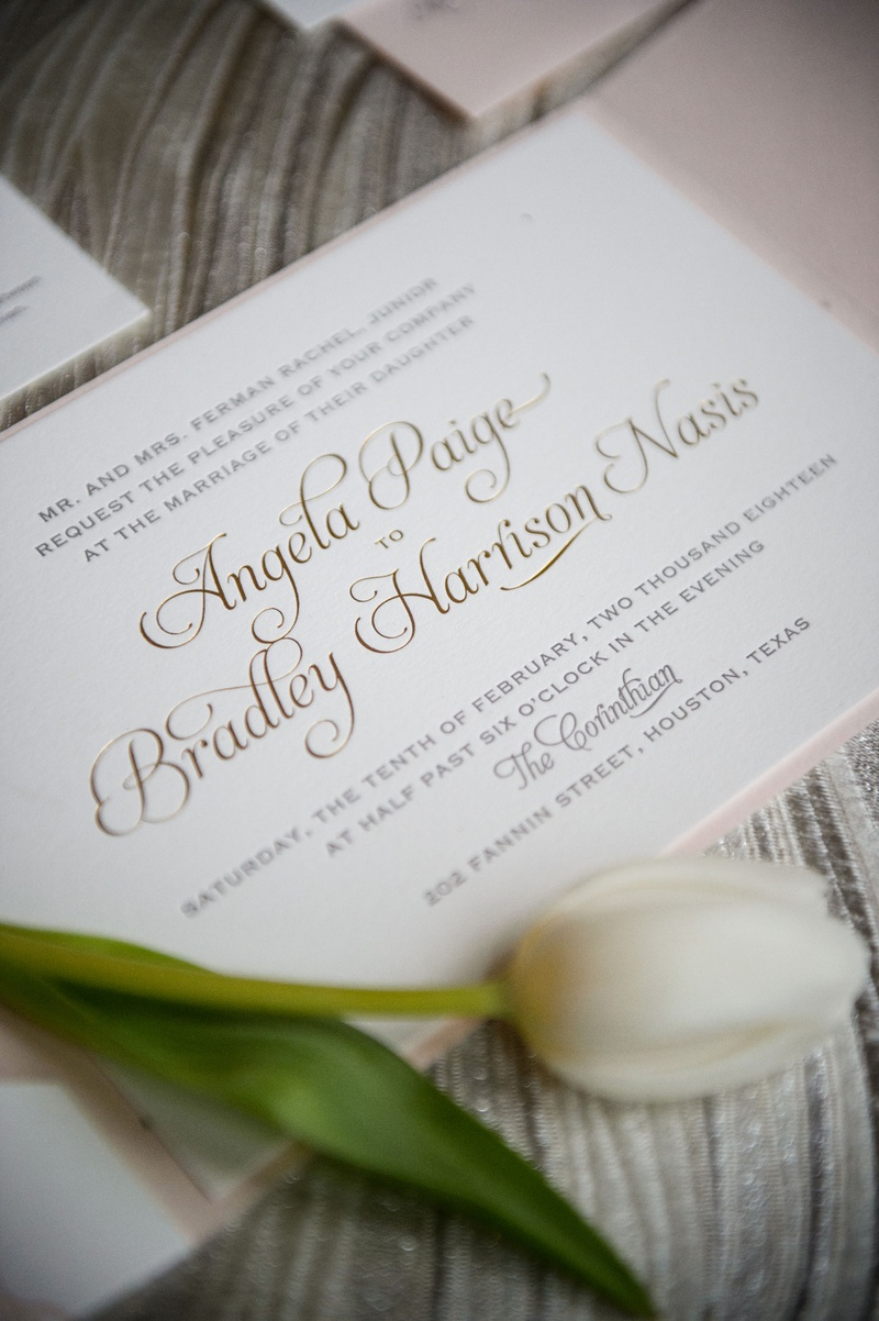 wedding invitation with tulip on top gold foil calligraphy script the corinthian houston invitation