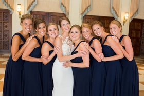 bride in pronovias atelier wedding dress, bridesmaids in amsale navy bridesmaid dresses