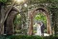 Groom in tuxedo bride in Galia Lahav wedding dress lace removable long sleeves church courtyard Chi