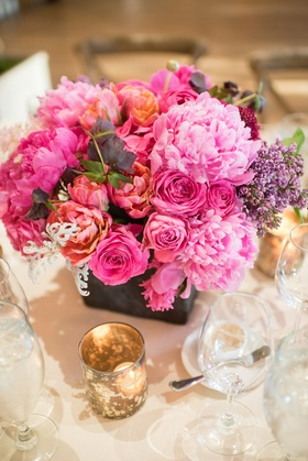 wedding floral centerpiece with vibrant pink flowers