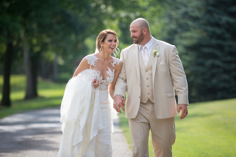 bride in pronovias gown with illusion neckline lace bodice, groom in tan suit, brian winters ny jets