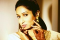 Bride with mehndi on hands and top eyeliner