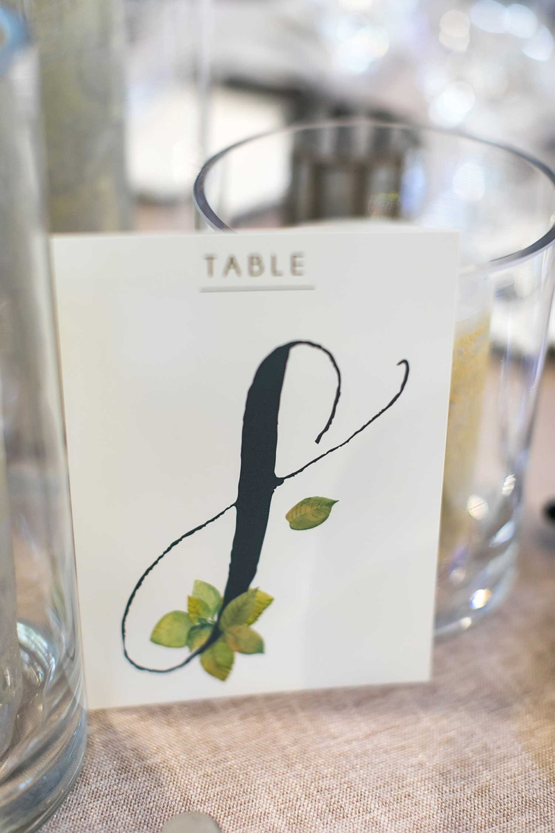 wedding reception table number rustic wedding ideas black calligraphy with green leaf illustration