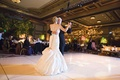 Illuminated ballroom walls and trumpet bridal gown
