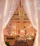 twinke lights within drapery at wedding reception