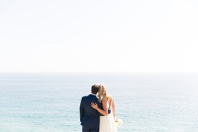 bride and groom looking out to the ocean, beach wedding, malibu wedding