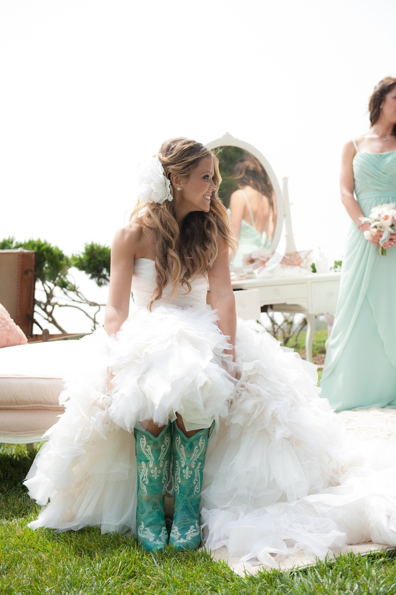 Katrina Hodgson in wedding dress with turquoise boots