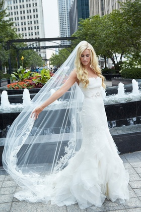 bride wearing vera wang cathedral veil and gown in Chicago