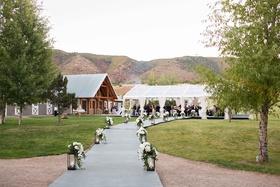 Aspen Colorado wedding ceremony Chaparral Ranch tent wedding lanterns white flowers
